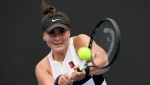 Canada's Bianca Andreescu makes a backhand return to United States' Whitney Osuigwe during their first round match at the Australian Open tennis championships in Melbourne, Australia, Tuesday, Jan. 15, 2019. (AP Photo/Andy Brownbill)