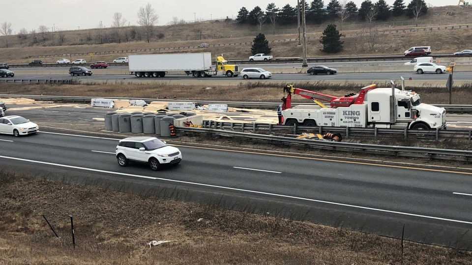 Truck rollover spills wood all over Highway 401 off-ramp | CP24 com