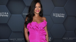 In this Sept. 14, 2018 file photo, singer Rihanna arrives at the Fenty Beauty by Rihanna one year anniversary party in New York. Rihanna is suing her father over his use of their last name for a business. In the lawsuit filed Tuesday in federal court in Los Angeles, Rihanna, whose full name is Robyn Rihanna Fenty, alleges that her father Ronald Fenty and his partner have violated her trademark and falsely suggested that their business, Fenty Entertainment, is affiliated with her.  (Photo by Evan Agostini/Invision/AP, File)