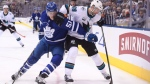 San Jose Sharks centre Melker Karlsson (68) and Toronto Maple Leafs defenceman Jake Gardiner (51) battle for the puck during second period NHL hockey action in Toronto on Wednesday Nov. 28, 2018. THE CANADIAN PRESS/Nathan Denette