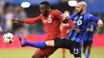"Toronto FC forward Jozy Altidore (17) battles for the ball with Montreal Impact defender Laurent Ciman (23) during first half action in the first leg of the MLS Eastern Conference final at the Olympic Stadium in Montreal on November 22, 2016. Toronto FC defender Laurent Ciman says while he has nothing but respect for his former team in Montreal as well as its fans, he wears red now. ""Now my club is Toronto,"" he said in French. ""Everybody knows very well I give everything for the club."" And the Belgian international said while he understands the rivalry between the two Canadian clubs, playing Montreal will be a match like every other for him. THE CANADIAN PRESS/Ryan Remiorz"