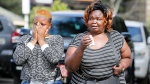 Women react after learning of a family member killed during a recent terrorist attack Wednesday, Jan. 16 2019, at the Chiromo Mortuary, Nairobi, Kenya. (AP Photo/Brian Inganga)