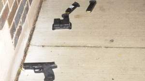 A gun used by Danforth shooter Faisal Hussain is shown on the ground near where his body was found. (Special Investigations Unit)