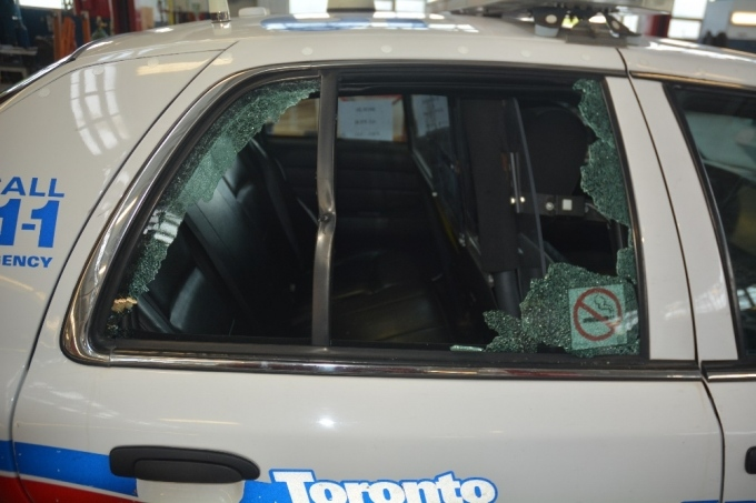 A shattered window on a police cruiser is shown following an exchange of gunfire between Danforth shooter Faisal Hussain and two responding officer. The SIU has said that the window was shattered by a bullet fired by one of the officers. (Special Investigations Unit)