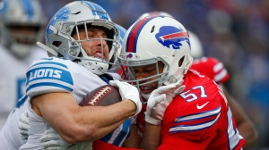 Detroit Lions running back Zach Zenner, left, is tackled by Buffalo Bills outside linebacker Lorenzo Alexander (57) during the first half of an NFL football game, Sunday, Dec. 16, 2018, in Orchard Park, N.Y. (AP Photo/Jeffrey T. Barnes)