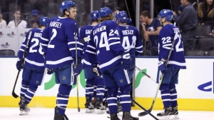 Toronto Maple Leafs players leave the ice after losing 6-3 to the Colorado Avalanche, at the end of third period NHL hockey action in Toronto on Monday, January 14, 2019. THE CANADIAN PRESS/Cole Burston