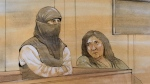 This courtroom sketch shows Rehab Dughmosh (left) and her interpreter during Wednesday's proceeding.
