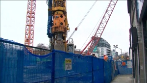 Construction crews are shown working on the Eglinton Crosstown near Bathurst Street and Eglinton Avenue.
