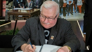 "Lech Walesa, the former Polish democracy activisit and ex-president, signs a condolence book for Gdansk Mayor Pawel Adamowicz, who died earlier this week after being stabbed by an ex-convict with a grudge against his former party, in Gdansk, Poland, on Wednesday Jan. 16, 2019. In the condolence book at the European Solidarity Center, Walesa, 75, wrote: """"Farewell, my friend, in this vale. We will meet soon in a better place."".(AP Photo/Anna Rezulak/KFP) POLAND AUT"