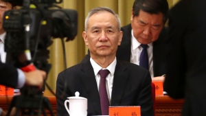 FILE - In this Jan. 2, 2019, file photo, Chinese Vice Premier Liu He attends an event to commemorate the 40th anniversary of the Message to Compatriots in Taiwan at the Great Hall of the People in Beijing. China's economy czar, Liu will visit Washington on Jan. 30-31 for talks aimed at ending a costly tariff war over U.S. complaints about Beijing's technology ambitions. (AP Photo/Mark Schiefelbein, Pool, File)