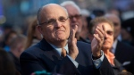 Former mayor of New York, Rudolph Giuliani watches  the Macy's Thanksgiving Day Parade in Times Square in New York on Thursday, Nov. 24, 2011. The parade premiered in 1924, this is its 85th year. (AP Photo/Andrew Burton)