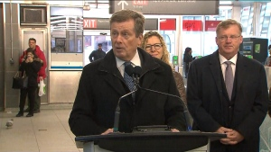 Mayor John Tory speaks with reporters at Pape Station on Thursday.