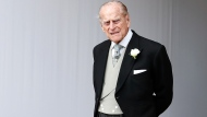 In this Friday, Oct. 12, 2018 file photo, Britain's Prince Philip waits for the bridal procession following the wedding of Princess Eugenie of York and Jack Brooksbank in St George's Chapel, Windsor Castle, near London, England. Buckingham Palace says Prince Philip the husband of Queen Elizabeth II had been in a traffic accident and is not injured. The palace said the accident happened Thursday, Jan. 17, 2019 afternoon near the queen's country residence in Sandringham in eastern England.(AP Photo/Alastair Grant, file)