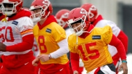 Kansas City Chiefs quarterback Patrick Mahomes (15) runs with teammates during a workout Thursday, Jan. 17, 2019, in Kansas City, Mo. The Chiefs host the New England Patriots in the NFL 's AFC football championship game on Sunday. (AP Photo/Charlie Riedel)