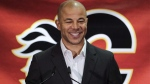 Former Calgary Flames captain Jarome Iginla announces his retirement from the NHL, after playing 20 seasons, at a news conference in Calgary on July 30, 2018. The Calgary Flames will retire former captain Jarome Iginla's No. 12 during a ceremony on March 2 prior to a game against the Minnesota Wild. The Edmonton native retired from the NHL after a 20-season career last July. THE CANADIAN PRESS/Jeff McIntosh