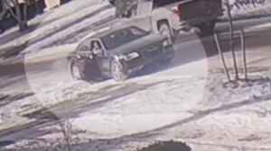 A woman is seen falling to the ground next to a vehicle in Newmarket on Jan. 11, 2019. (YRP)