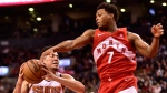 Toronto Raptors guard Kyle Lowry (7)gets a hand to the ball as Phoenix Suns guard Devin Booker (1) drives for the basket during second half NBA basketball action in Toronto on Thursday Jan. 17, 2019. THE CANADIAN PRESS/Frank Gunn