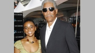 "In this July 14, 2008 file photo, actor Morgan Freeman and step-granddaughter E'Dena Hines attend the world premiere of ""The Dark Knight"" in New York. (AP Photo/Evan Agostini, File)"