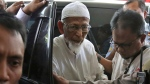 In this March 1, 2018, file photo, ailing radical cleric Abu Bakar Bashir, center, arrives for medical treatment at Cipto Mangunkusumo Hospital in Jakarta, Indonesia. A lawyer for the ailing radical cleric who inspired the Bali bombers said Friday, Jan. 18, 2019, the Indonesian government will release him from prison next week. (AP Photo/Dita Alangkara, File)