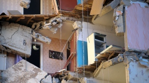 FILE - In this file photo dated Monday, Dec. 31, 2018, apartments are exposed after an explosion and the building partially collapsed, in Magnitogorsk, about 1,400 kilometers (870 miles) southeast of Moscow, Russia. The Russian Investigative Committee on Friday Jan. 18, 2019, denied claims of responsibility by Islamic State online newspaper al-Nabaa, saying Russian authorities believe a gas leak to be the likeliest cause of the explosion. (AP Photo/Maxim Shmakov, FILE)