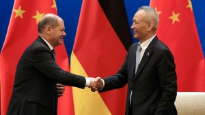 German Finance Minister Olaf Scholz, left, shakes hands with Chinese Vice Premier Liu He after they witnessed a signing ceremony for the China-Germany High Level Financial Dialogue at the Diaoyutai State Guesthouse in Beijing, Friday, Jan. 18, 2019. (AP Photo/Andy Wong, Pool)
