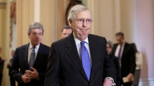 In this Jan. 15, 2019, photo, Senate Majority Leader Mitch McConnell, R-Ky., arrives to speak to reporters following a weekly policy meeting on Capitol Hill in Washington. One of McConnell's guiding principles is: 'There's no education in the second kick of a mule.' Now, deep in a government shutdown he wanted President Donald Trump to avoid, McConnell is not about to be kicked again. (AP Photo/J. Scott Applewhite)