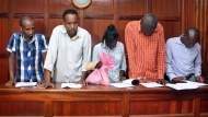 From left to right, suspects Osman Ibrahim, Guleid Abdihakim, Gladys Kaari Justus, Oliver Kanyango Muthee and Joel Nganga Wainaina appear at a hearing at Milimani law courts in Nairobi, Kenya Friday, Jan. 18, 2019. Police who are investigating this week's extremist attack on a Nairobi hotel complex asked the court that the suspects who are accused of involvement in the attack be held for 30 days in order for the police to complete their investigations, which the court granted. (AP Photo)