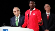 In this Wednesday, June 13, 2018 file photo, Alphonso Davies of Canada speaks at the FIFA congress on the eve of the opener of the 2018 soccer World Cup in Moscow. (AP Photo/Alexander Zemlianichenko, file)