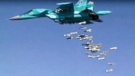 In this file image made from video provided by Russian Defense Ministry press service on Aug. 18, 2016, shows a Russian combat fighter bomber Su-34 unloads its bombs over a target in Syria. Two Su-34's similar to this one collided in mid-air over the Sea of Japan on Jan. 18, 2019. (Russian Defense Ministry Press Service photo via AP, File)