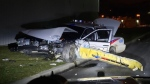 A damaged police cruiser is seen partially up on a curb following a crash on Jan. 1, 2019. (Courtesy: Toronto Sun)