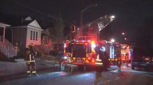 Crews battle a fire at a home in Toronto's Briar Hill neigbourhood on Friday, Jan. 18, 2019.