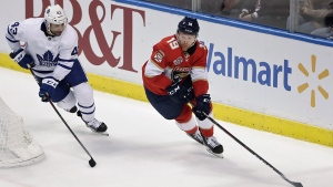 Florida Panthers defenseman Mike Matheson controls the puck next to Toronto Maple Leafs center Nazem Kadri during the third period of an NHL hockey game Friday, Jan. 18, 2019, in Sunrise, Fla. (AP Photo/Brynn Anderson)