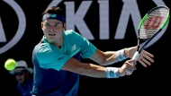 Canada's Milos Raonic makes a backhand return to France's Pierre-Hugues Herbert during their third round match at the Australian Open tennis championships in Melbourne, Australia, Saturday, Jan. 19, 2019. (AP Photo/Mark Schiefelbein)