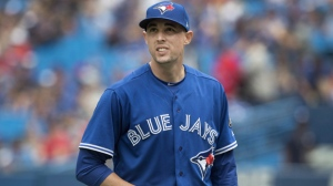 Toronto Blue Jays starting pitcher Aaron Sanchez walks back out to the mound in the seventh inning of their American League MLB baseball game against the Baltimore Orioles in Toronto on Saturday June 9, 2018. Blue Jays right-hander Aaron Sanchez believes his finger troubles are finally over. THE CANADIAN PRESS/Fred Thornhill