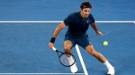 Switzerland's Roger Federer plays a shot to Greece's Stefanos Tsitsipas during their fourth round match at the Australian Open tennis championships in Melbourne, Australia, Sunday, Jan. 20, 2019. (AP Photo/Aaron Favila)
