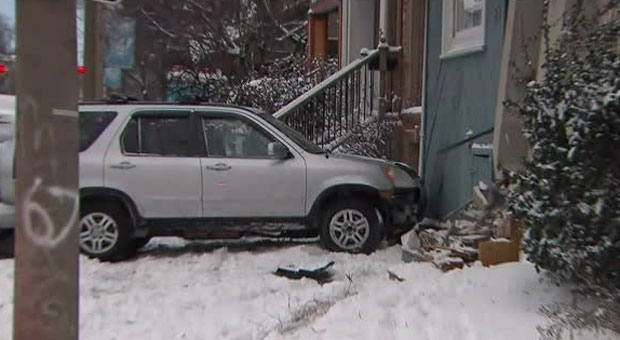 A car crashed into a house in the city's east end on Sunday morning.