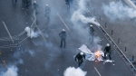 Greek riot police uses tear gas to disperse demonstrators during clashes in Athens, Sunday, Jan. 20, 2019. Greece's Parliament is to vote this coming week on whether to ratify the agreement that will rename its northern neighbor North Macedonia. Macedonia has already ratified the deal, which, polls show, is opposed by a majority of Greeks. (AP Photo/Thanassis Stavrakis)