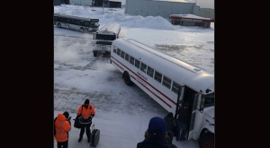 Passengers leave a plane and board buses to change planes in Happy Valley-Goose Bay, N.L., on Sunday, Jan. 20, 2019. An end is finally in sight for passengers who spent about 16 gruelling hours on a plane grounded at an airport in frigid Happy Valley-Goose Bay, Labrador. United Flight 179 from Newark, N.J., to Hong Kong was diverted to the Goose Bay Airport Saturday night after a passenger experienced a medical emergency, according to United Airlines spokeswoman Natalie Noonan. THE CANADIAN PRESS/HO - Sonjay Dutt