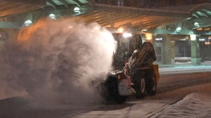 Crews clear snow at the Albany International Airport in Colonie, N.Y., Sunday, Jan. 20, 2019. A major winter storm that blanketed much of the Midwest with snow earlier in the weekend is barreling toward New England, where it is expected to wreak transportation havoc from slick and clogged roads to hundreds of canceled airline flights. (AP Photo/Hans Pennink)