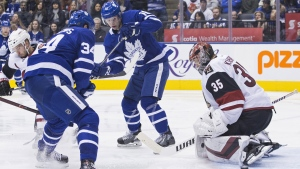Arizona Coyotes goaltender Darcy Kuemper makes a stop in front of Toronto Maple Leafs' Auston Matthews (left) and Mitchell Marner during second period NHL hockey action in Toronto on Sunday, January 20, 2019.THE CANADIAN PRESS/Chris Young