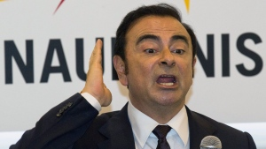 FILE - In this April 25, 2016, file photo, then Renault-Nissan's CEO Carlos Ghosn speaks during a press conference held at Auto China 2016 in Beijing, China.  (AP Photo/Ng Han Guan, File)