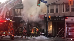 Toronto firefighters battle a blaze at an establishment on Danforth and Chester on January 22, 2019. (Keith Hanley/CTV News Toronto)