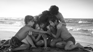 "This image released by Netflix shows Yalitza Aparicio, center, in a scene from the film ""Roma,"" by filmmaker Alfonso Cuaron. On Tuesday, Jan. 22, 2019, the film was nominated for an Oscar for best foreign language film. The 91st Academy Awards will be held on Feb. 24. (Carlos Somonte/Netflix via AP)"