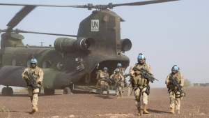 Canadian infantry and medical personnel disembark a Chinook helicopter as they take part in a medical evacuation demonstration on the United Nations base in Gao, Mali, Saturday, December 22, 2018. THE CANADIAN PRESS/Adrian Wyld
