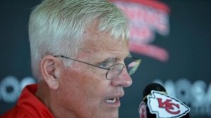 In this Aug. 9, 2015, file photo, Kansas City Chiefs defensive coordinator Bob Sutton addresses the media during an NFL football training camp practice, in St. Joseph, Mo. The Chiefs are down a handful of starters on defense, and they've faced some high-powered offenses. But the numbers they're allowing has turned up the pressure on defensive coordinator Bob Sutton. (Andrew Carpenean/The News-Press via AP, File)