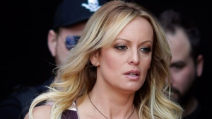 In this Oct. 11, 2018, file photo, adult film actress Stormy Daniels arrives for the opening of the adult entertainment fair Venus in Berlin. A federal judge in Los Angeles, on Tuesday, Jan. 22, 2019, appeared inclined to toss out a lawsuit against President Donald Trump by Daniels that seeks to tear up a hush-money settlement about their alleged affair. Her attorney Michael Avenatti argued the case should continue because he wanted to take sworn statements from Trump and Cohen. He plans to ask for legal fees. (AP Photo/Markus Schreiber, File)