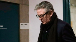 """Actor Alec Baldwin arrives in a New York court, Wednesday, Jan. 23, 2019, for a hearing on charges that he slugged a man during a dispute over a parking spot last fall. He's charged with misdemeanor attempted assault and harassment, a violation. Baldwin has denied punching anyone in the Nov. 2, 2018 clash. The former """"30 Rock"""" star's lawyer says he'll be vindicated by """"incontrovertible video evidence."""" (AP Photo/Mark Lennihan)"""