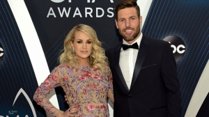 In this Nov. 14, 2018 file photo, Carrie Underwood and her husband Mike Fisher arrive at the 52nd annual CMA Awards in Nashville, Tenn. Underwood and Fisher announced the birth of their second son, Jacob Bryan Fisher, in a post on Instagram. The 35-year-old singer posted photos of the newborn, who she said was born early Monday, Jan. 21. (Photo by Evan Agostini/Invision/AP, File)
