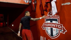 Toronto FC defender Gregory van der Wiel (9) leaves the field after defeating Atlanta United during MLS soccer action in Toronto, Sunday, Oct. 28, 2018. THE CANADIAN PRESS/Cole Burston