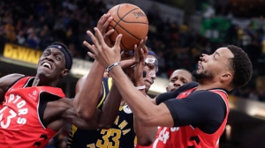 Indiana Pacers center Myles Turner (33) battles with Toronto Raptors forward Pascal Siakam (43) and forward Norman Powell (24) during the second half of an NBA basketball game in Indianapolis, Wednesday, Jan. 23, 2019. The Pacers won 110-106. (AP Photo/Michael Conroy)